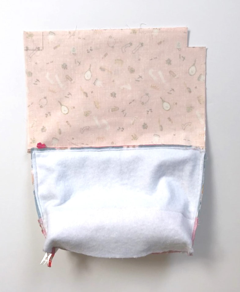 fabric for makeup bag with plastic lining on white tabletop