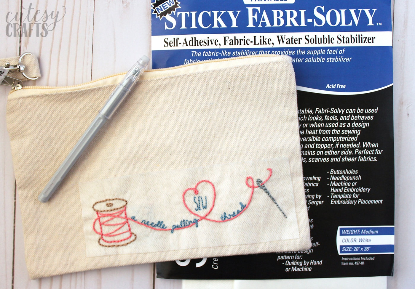 Hand embroidery designs on zip bag on white tabletop