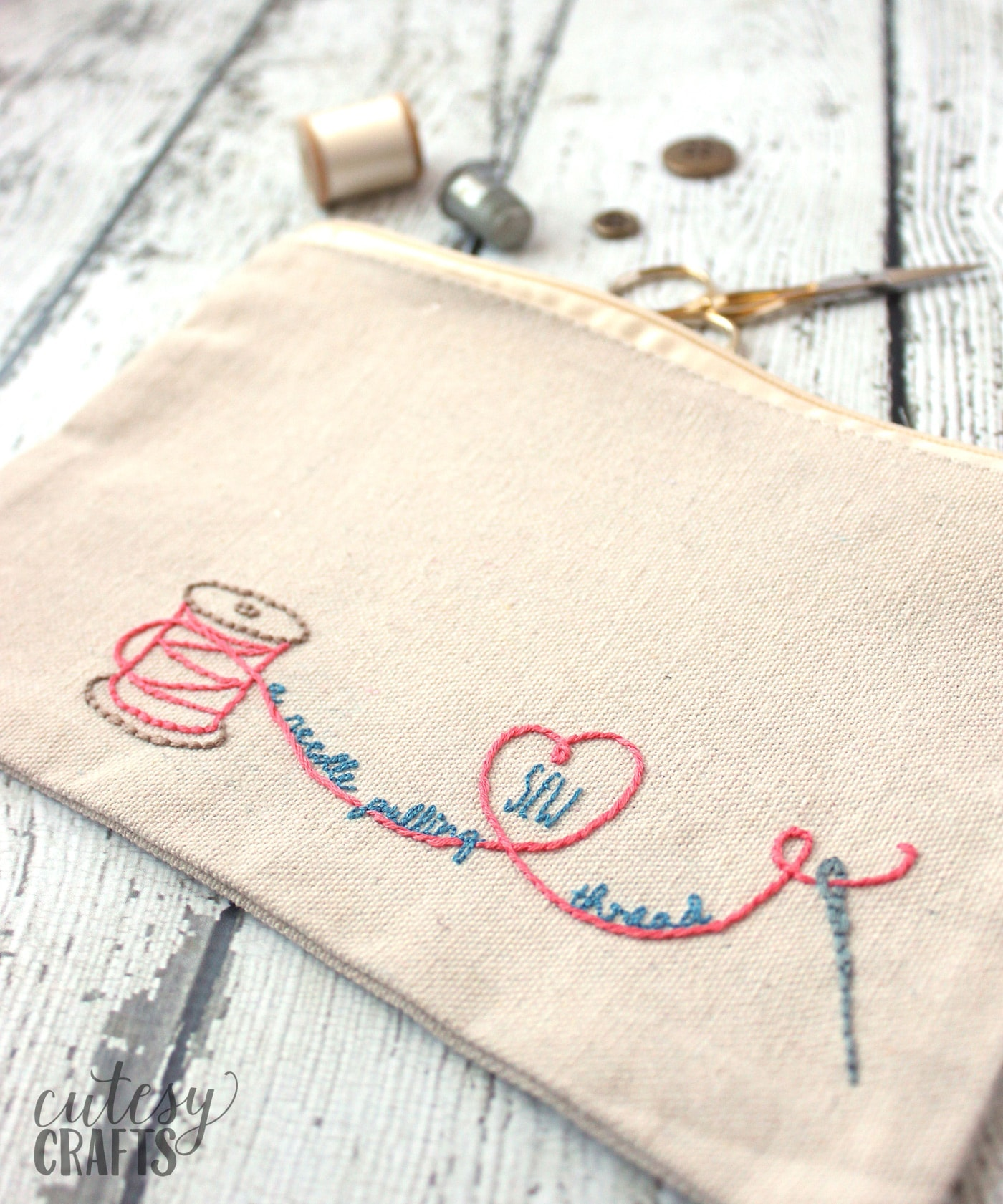 Hand embroidered zip bag on white tabletop