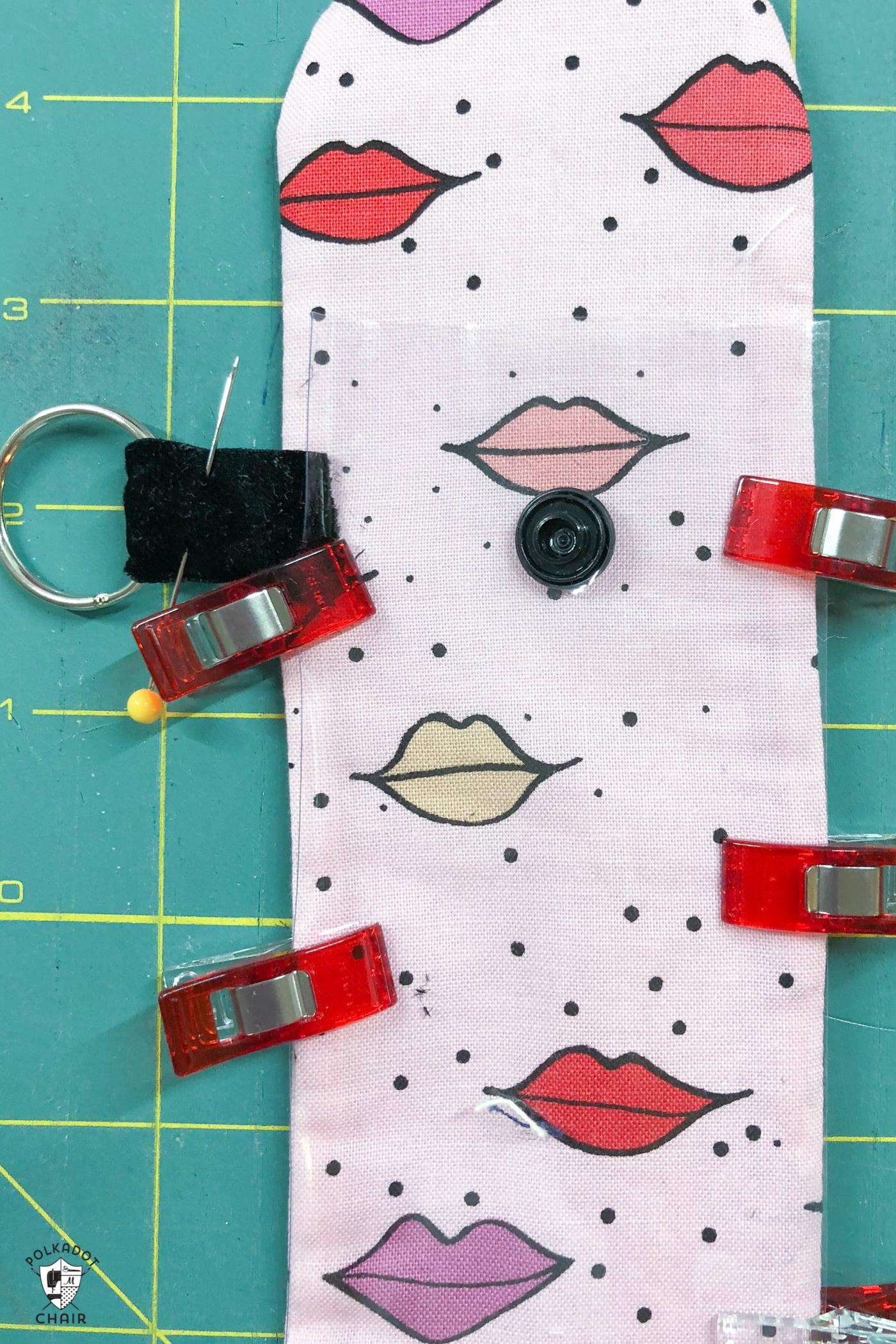lip gloss case pieces on green cutting mat