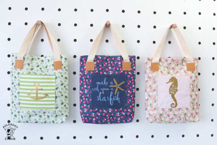 Tote bags on white peg board