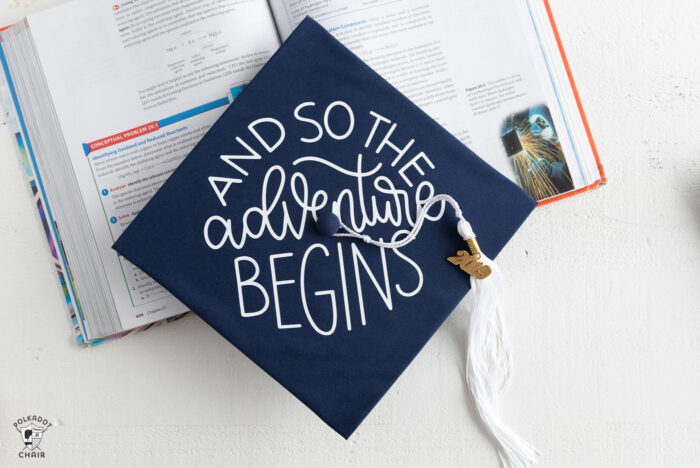 Decorated Graduation Caps on white table