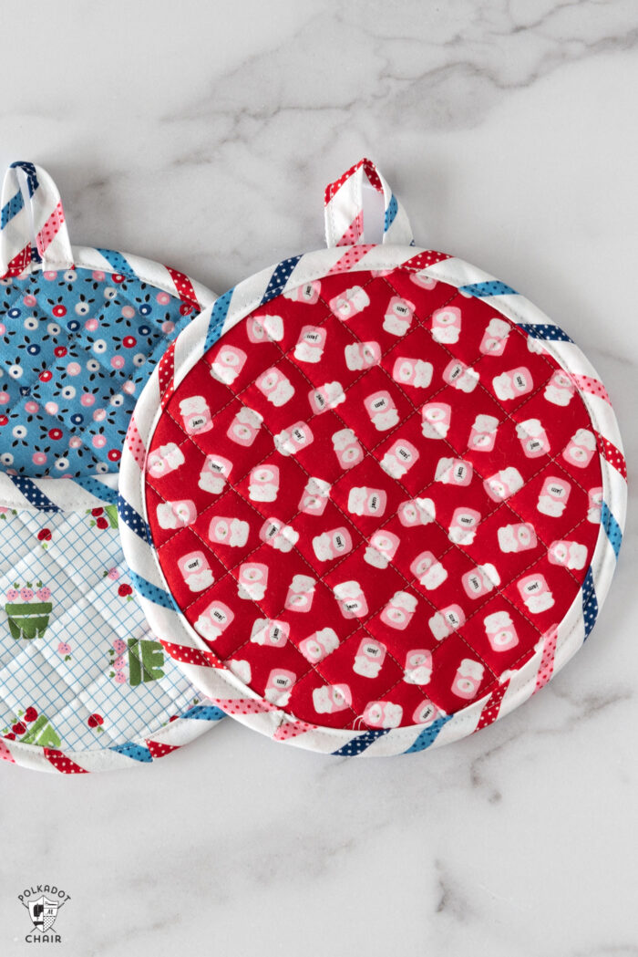 Round pot holders on white table