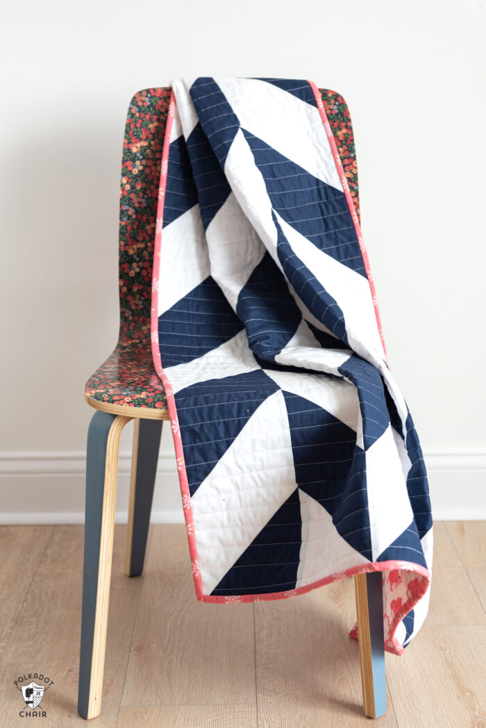 navy and white herringbone quilt on chair