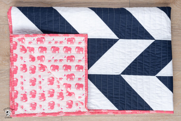 navy and white herringbone quilt with pink backing