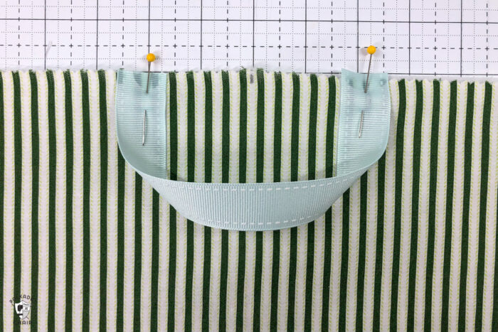 Reading pillow construction steps on white cutting mat