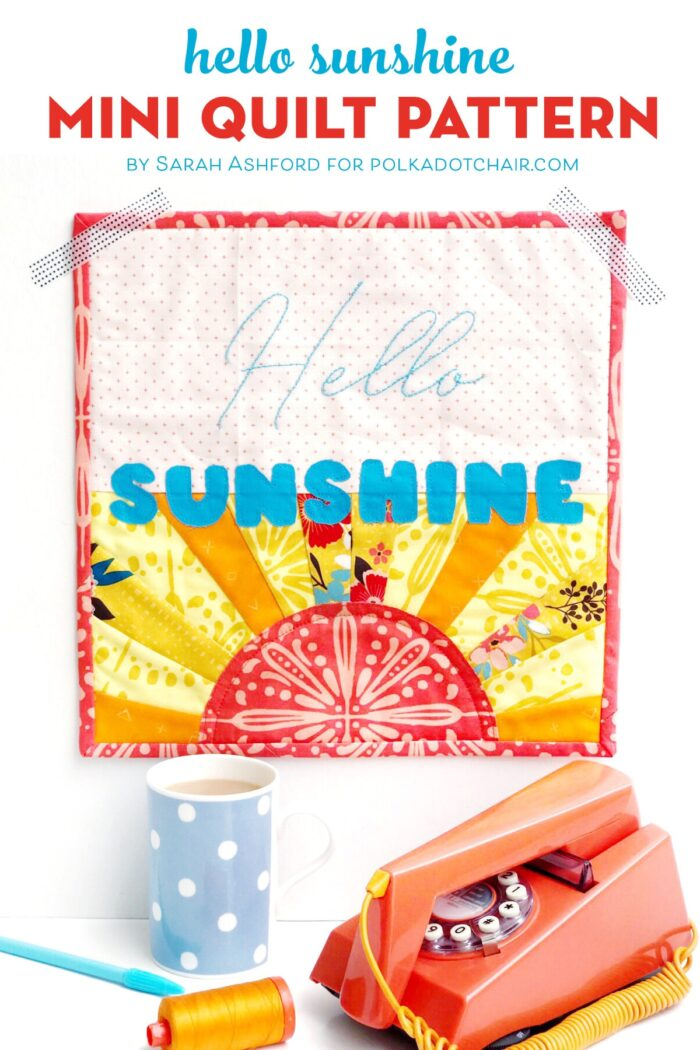 Hello Sunshine Mini quilt on white wall