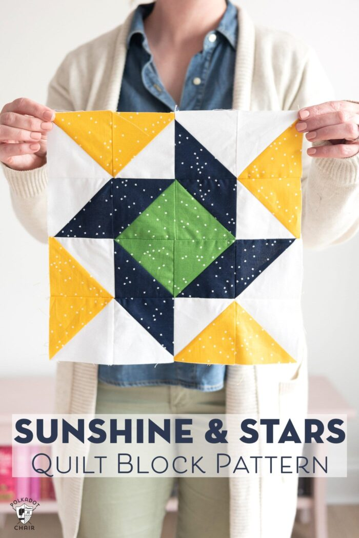 Sunshine and Stars Quilt block being held up