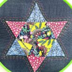 English Paper Pieced Star Block in embroidery hoop