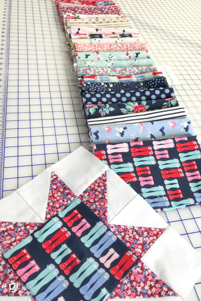 stacks of colorful fabric folded on white cutting table