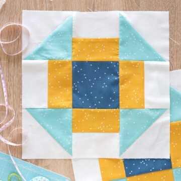 Churn Dash Quilt Block on table
