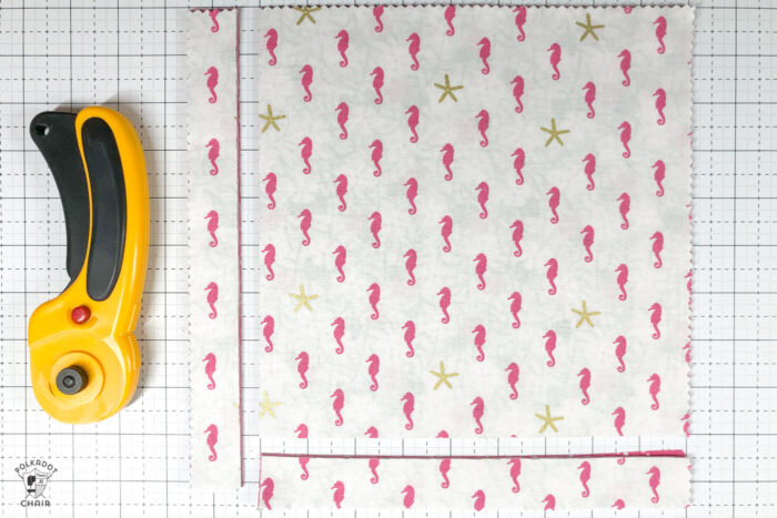 """10"""" pre cut fabric squares on cutting mat"""