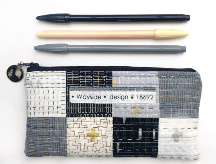 Simple quilted patchwork pencil case on white table