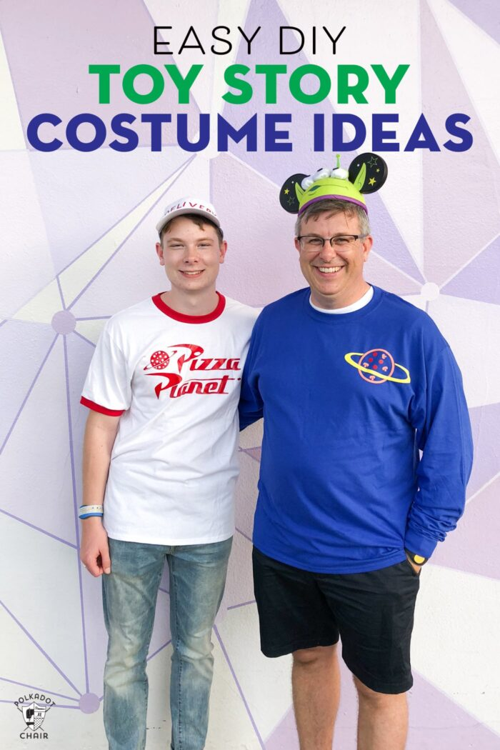 Pizza Planet and Green Alien Costumes on 2 persons in front of purple wall.