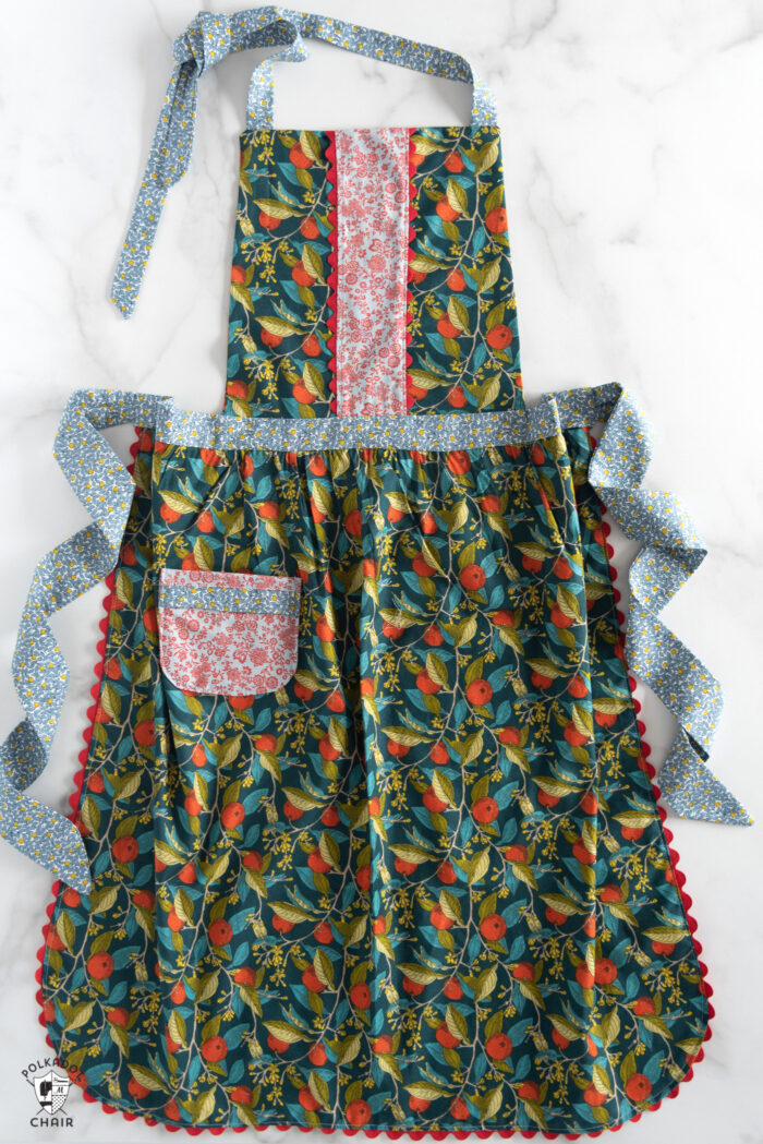 free apron sewing pattern from liberty london fabric on white table
