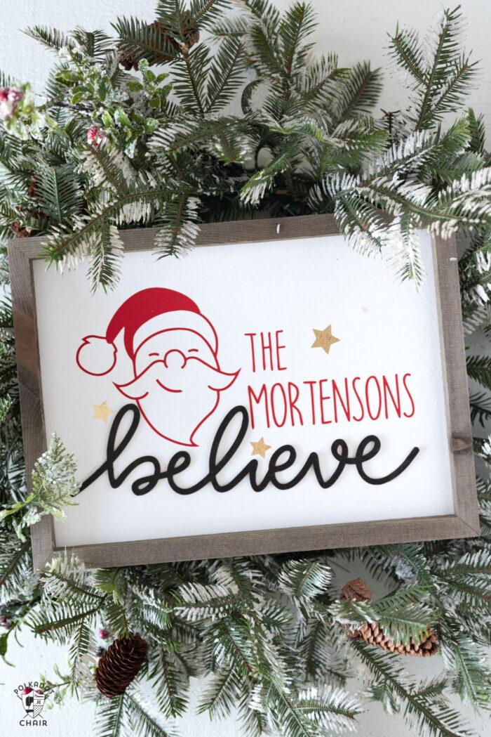 Believe Wood Christmas Sign on Christmas wreath