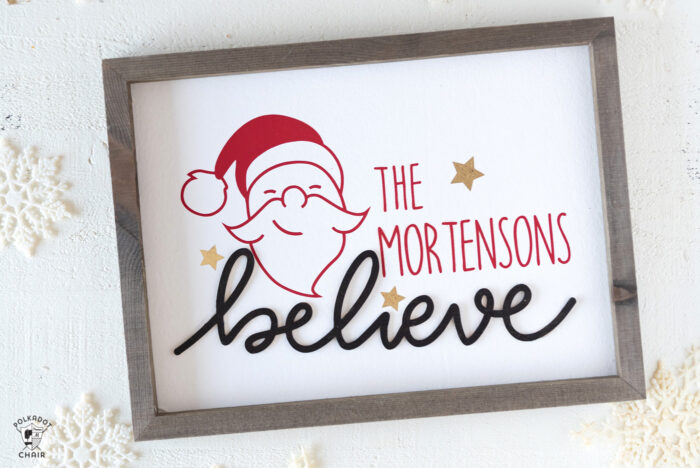 Believe Wood Christmas Sign on white table