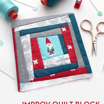 Improv quilt block needle case on white table