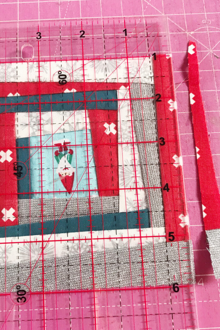 squaring up improv quilt block on pink cutting mat