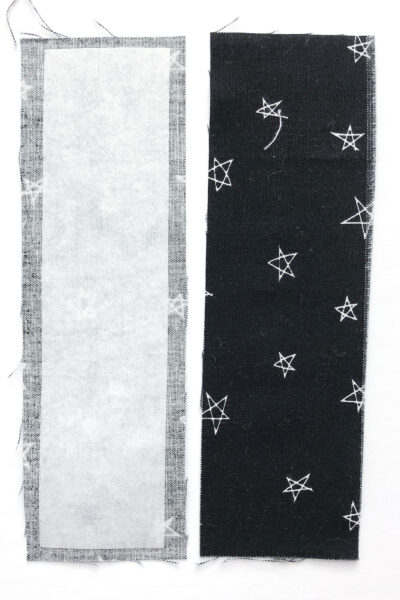 black fabric cut and ready to be sewn into bookmark