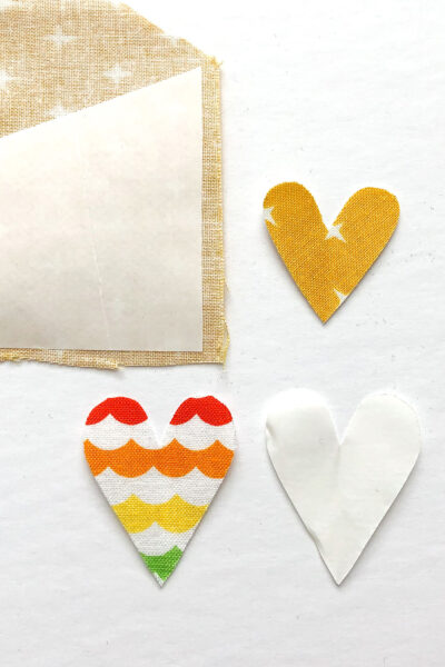 heart appliques in various states of construction on white table