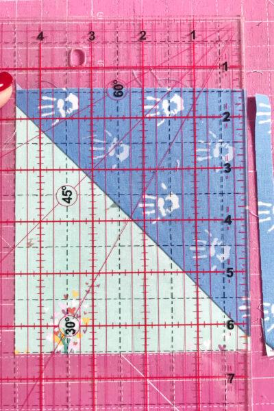 quilt ruler on pink cutting mat