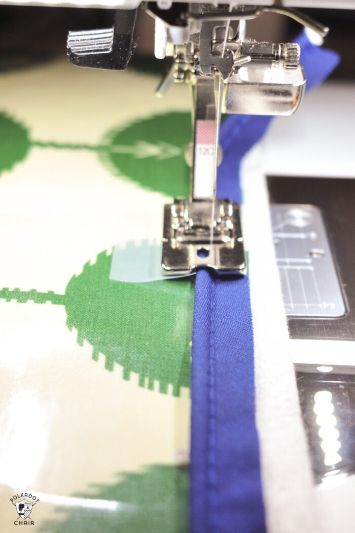 cording presser foot sewing on piping onto laminated green fabric