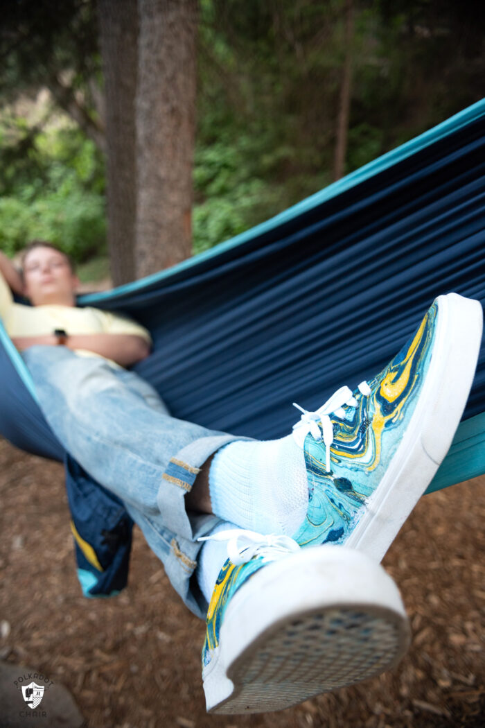 person in hammock wearing hydro dipped vans
