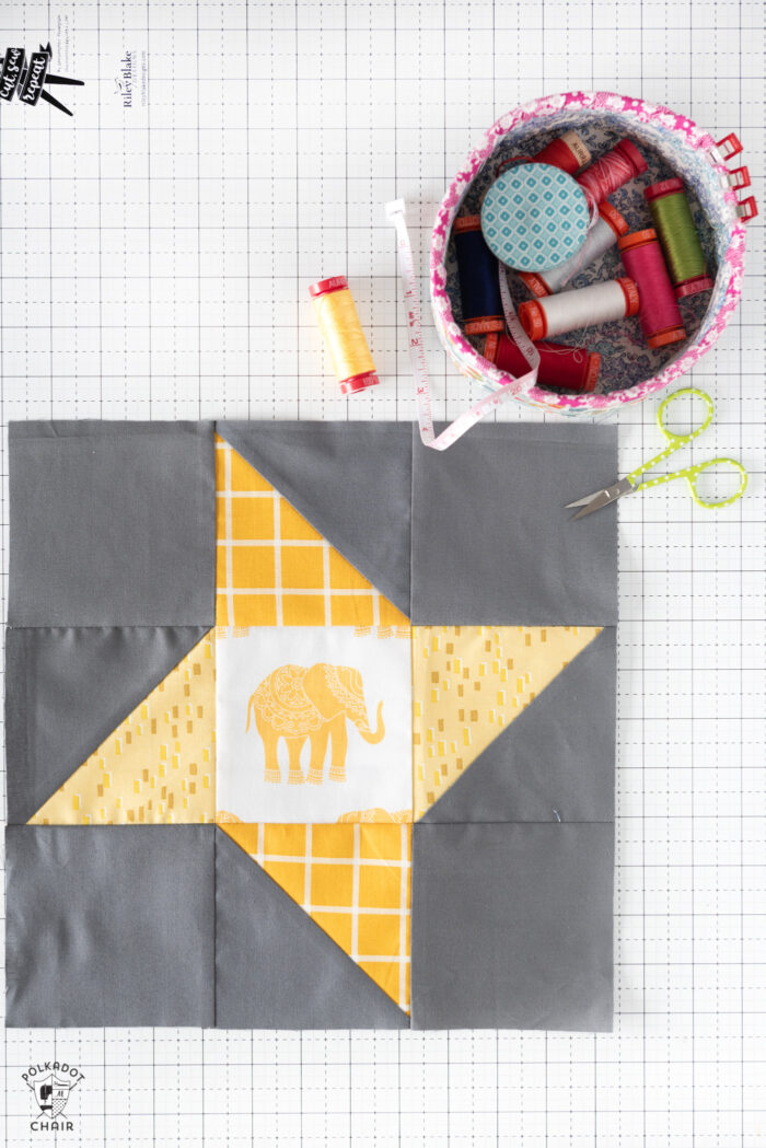 Friendship star quilt block on white cutting mat