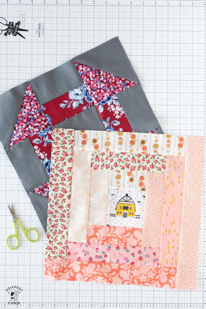 log cabin and churn dash quilt block on white cutting mat