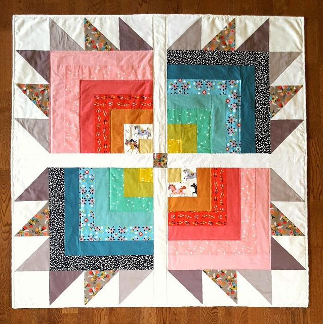 quilt blocks in various colors on white cutting mat