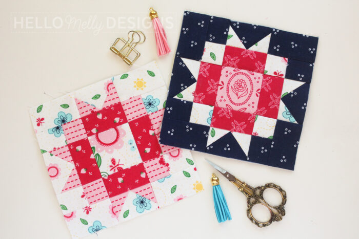 navy and red quilt blocks on white table with scissors
