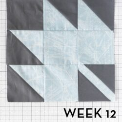 colorful quilt blocks on white cutting mat