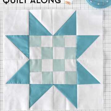 blue and white quilt block pieced on white cutting mat