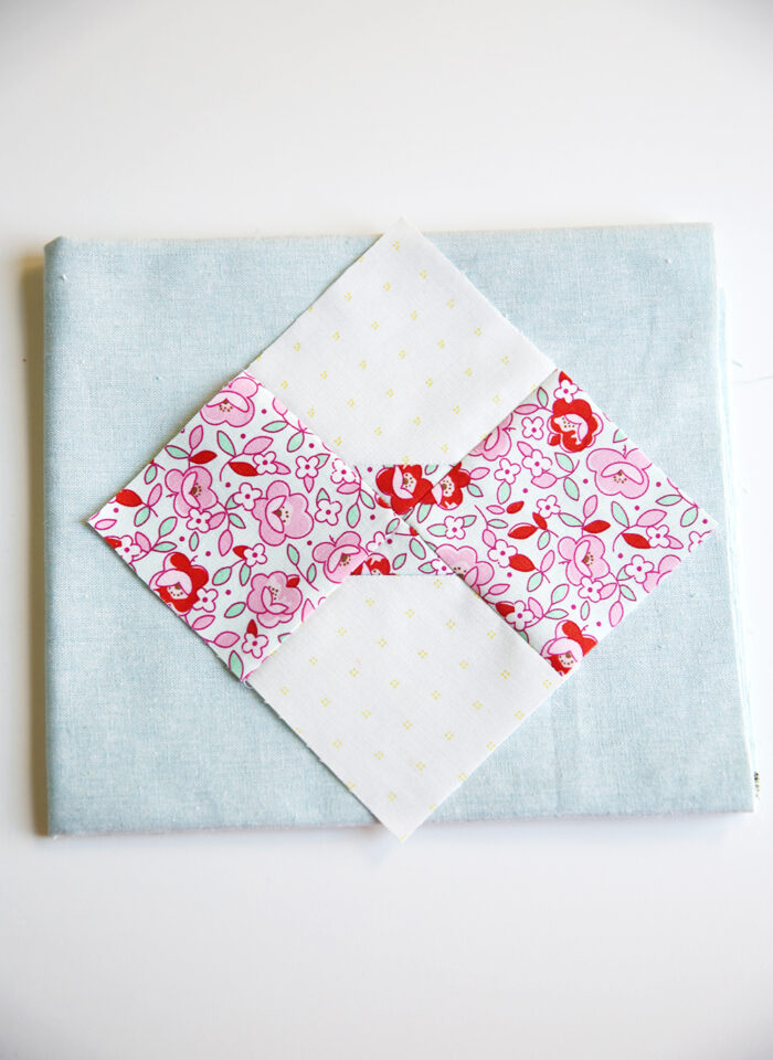 bow tie quilt block on white table