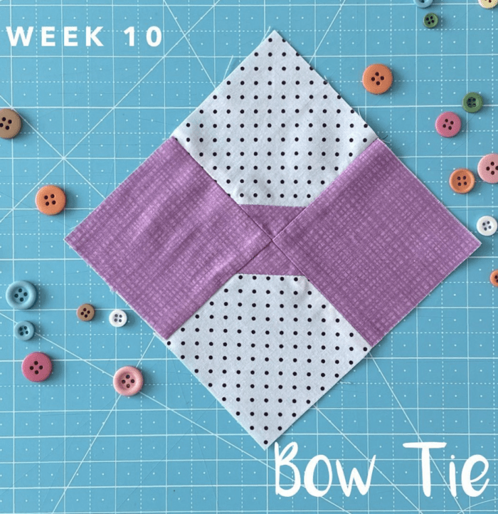 bow tie quilt block on blue cutting mat