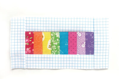 cut fabric for pencil pouch on white table