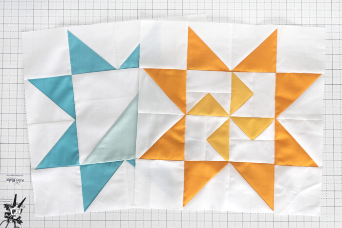 blue quilt block and yellow quilt block on white cutting mat