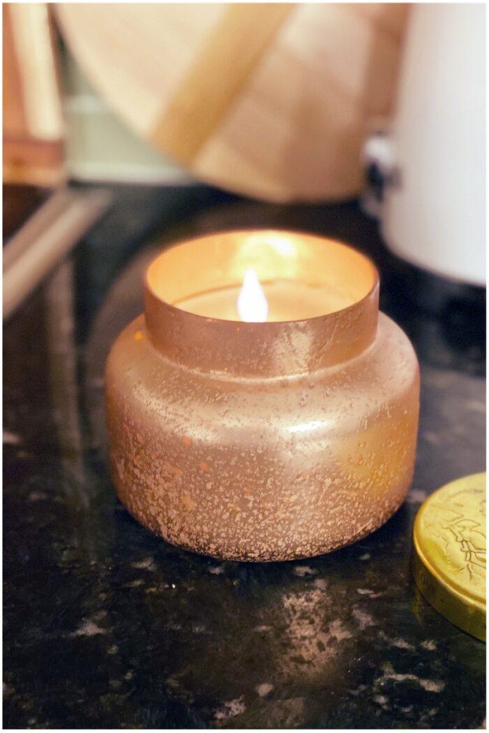 photo of orange candle on black granite countertop