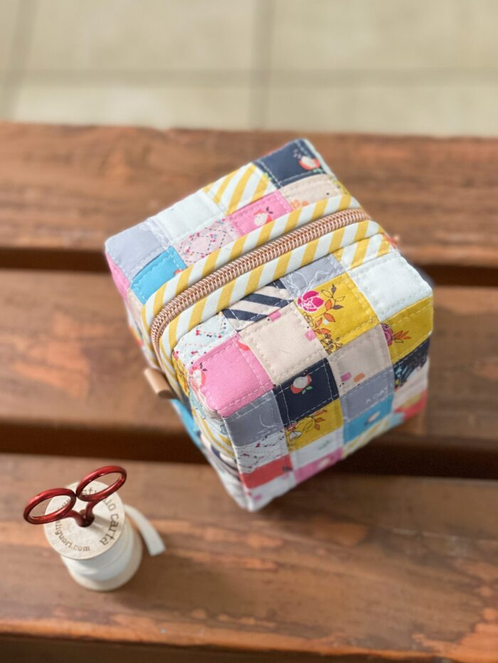 colorful patchwork box pouch on wood table