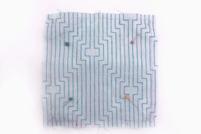 pinned square of fabric