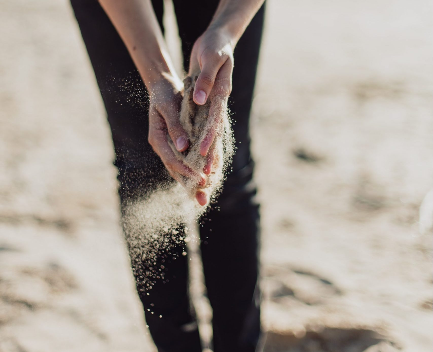 sand slipping through hands