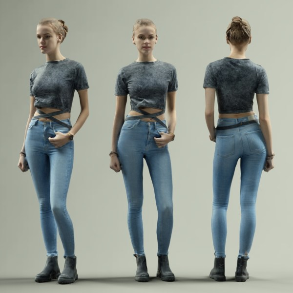 Girl in Jeans and Grey Top Posing and Smiling