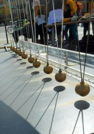 In The Shadow Of Newton's Cradle
