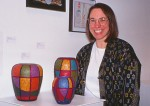 Margaret Maggio with her installation at MIPCES exhibition