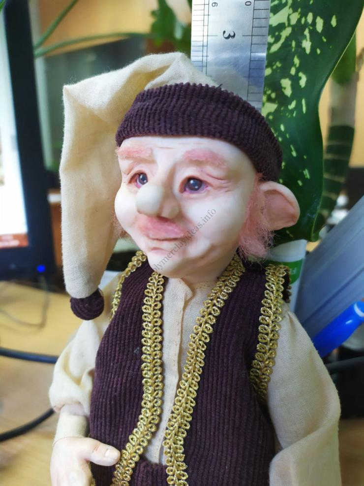 The cute gnome figurine is made of baked polymer clay