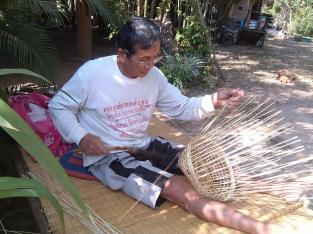 Old man with his bamboo handicraft