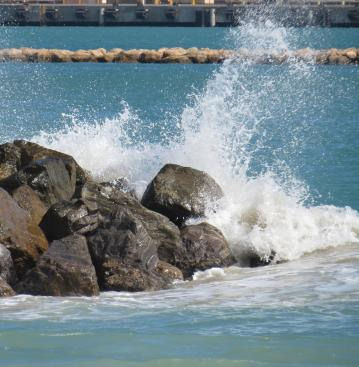 The ocean meets the rocks in a turbulent burst of spray