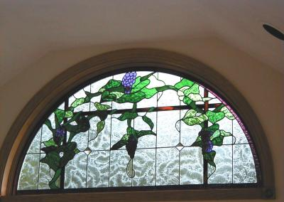 Andersen circle top window with stained glass