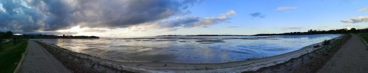 Sunset on Ōmokoroa beach. The tide is right out ad the pink and blue of the evening reflected on it is quite charming, but not as pink as it could have been just a moment earlier.